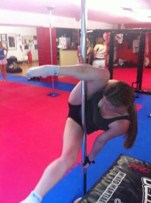 Beginner pole dance student