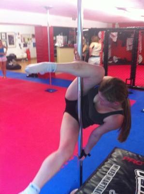Beginner pole dance student