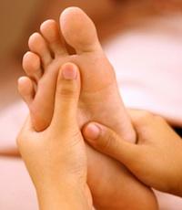 rubbing sore feet