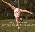 advanced pole dancer performing inversion