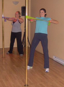 Students doing pole strengthening exercises