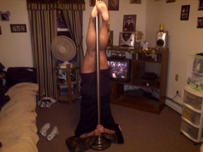 Headstand on a dance pole